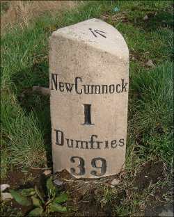 detail of New Cumnock milestone at NS609147