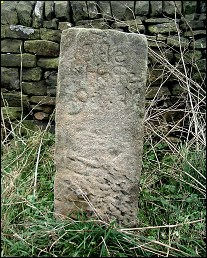 detail of Wet Shaw Lane guide stone at SK245904