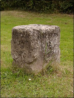 detail of Caxton milestone at TL302587