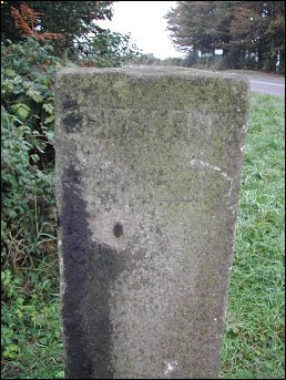 extra detail of Lickpenny Lane Crossroads guide stone at SK343592